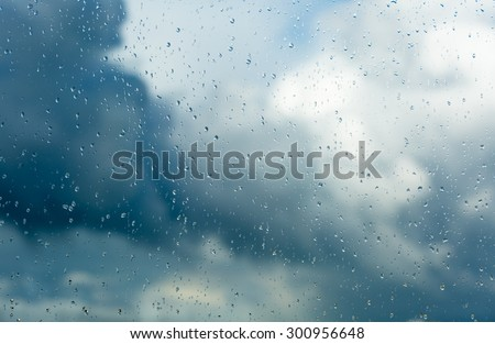 Raindrops on a window during bad, rainy weather. #300956648