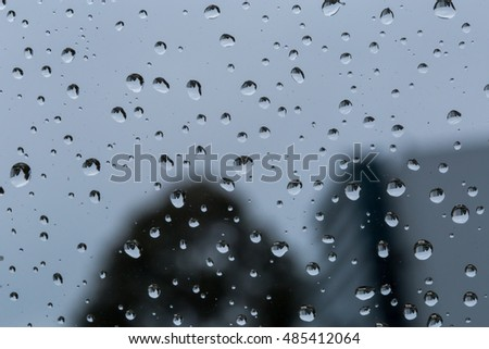 Raindrops on a windshield with a blurred out background #485412064