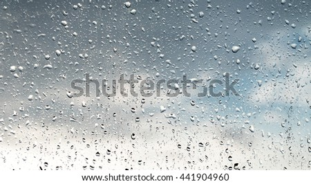 raindrops on glass #441904960