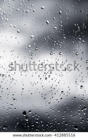 raindrops on glass unfocused #412885516