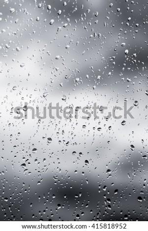 raindrops on glass unfocused #415818952
