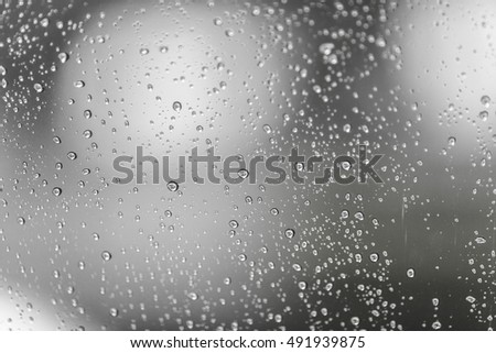 Raindrops on glasses surface. Natural Pattern of rain drops isolated on cloudy background. #491939875