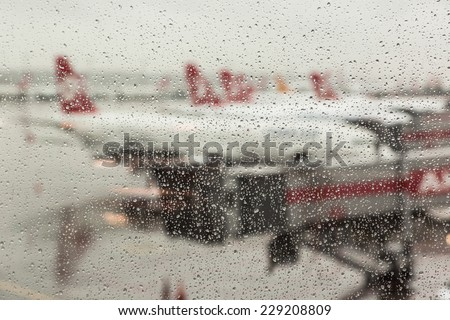 Raindrops on the Airport Window #229208809