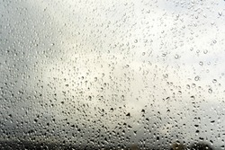 Raindrops on the window. Landscape through the humid glass. Metaphor of bad mood, depression and sadness