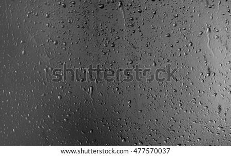 Raindrops on the window on the dark background #477570037