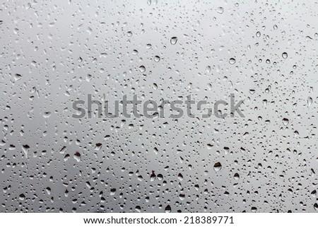 raindrops on window glass #218389771