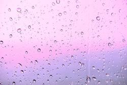 raindrops on window glass for background.purple color