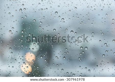 Raindrops over the window with blurred background in vintage sad tone