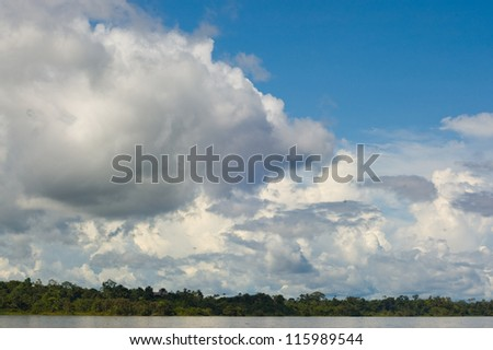 Rainforest and cloudy sky over the Amazon River, Peru