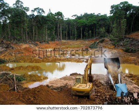 Rainforest destruction. Gold mining place in Guyana, South America. Similar as in Brazil.\ Amazon and Essequibo basin deforestation. Brazil deforestation. Venezuela deforestation.