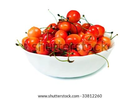 rainier cherries in bowl over white