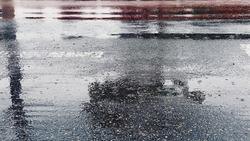Raining on the road with gloomy mind