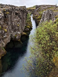 Raining on the Silfra Tectonic Plate Rift Fissure at Thingvellir National Park in Iceland