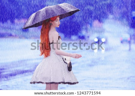 Raining weather. Autumn rain. Sick girl in depression in dress hold umbrella.  Umbrella protection against street. Lonely woman with disease was caught in rain. Sick girl in sorrow.