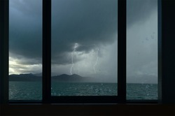 Rains and lightning over the mountains in the sea