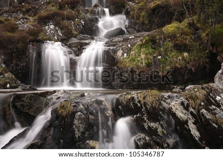 Rainwater cascading down a hillside in the Scottish Highlands.