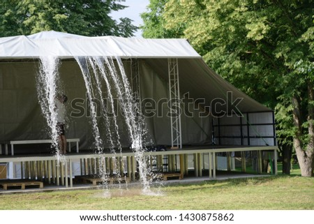 rainwater is pushed from a canopy above the stage before the festival begins  #1430875862