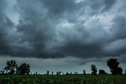 Rainy clouds over horizon