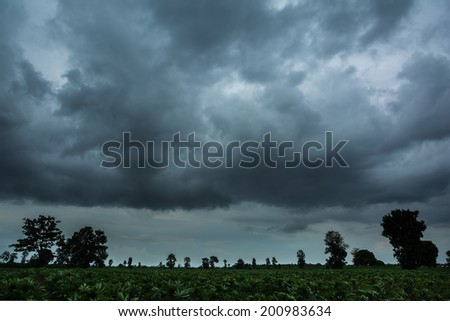 Rainy clouds over horizon