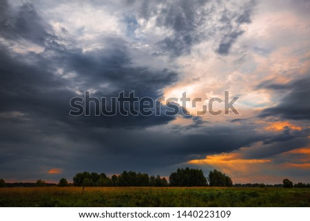 Rainy cloudy dawn over the flood meadows of the Ob river. Meret village district, Suzun district, Novosibirsk region, Western Siberia, Russia