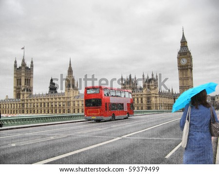Rainy day at the Houses of Parliament with red bus and blue girl, London, UK