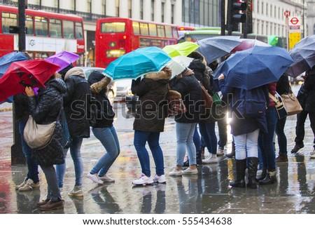 Rainy day umbrella Windy in London