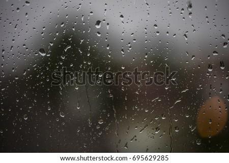 rainy days, rain drops on the window  #695629285