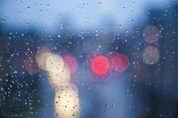 Rainy days,Rain drops on window,rain background,rain and bokeh,rainy weather
