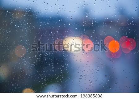 Rainy days,Rain drops on window,rainy weather,rain and bokeh