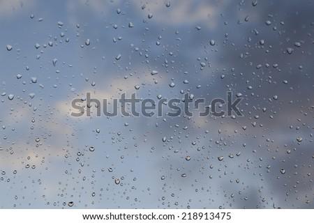 Rainy days,Rain drops on window,rainy weather,rain background,rain and bokeh