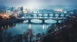 rainy night view of charles bridge at prague in czech winter. charles bridge in praha