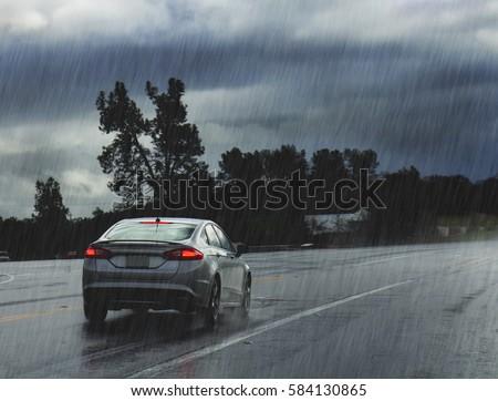 Rainy road with car