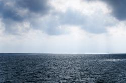 Rainy sky over the grey sea,.