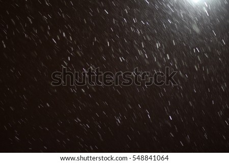 "Rainy texture. Bokeh lights and Falling rain dropson a black background for use as a texture layer in your project. Add as ""Lighten"" Layer in Photoshop to add falling droplets to any image."