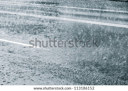 Rainy weather on a city street - stock photo