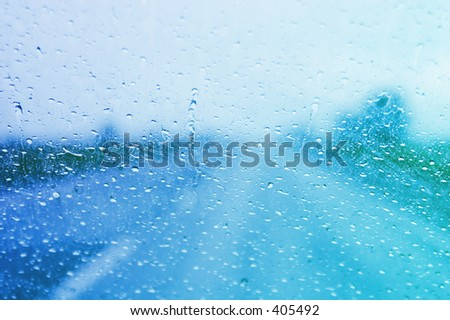 Rainy windshield on a stormy day - stock photo