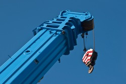raised boom 250 ton truck crane against the sky