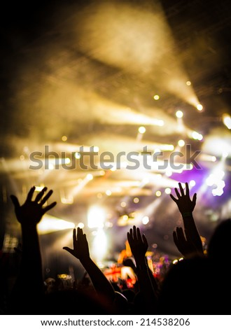 Raised cheering hands at party