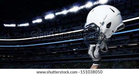Raised Football Helmet at an American Football Stadium