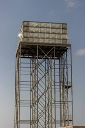 raised up steel water tower on steel frame