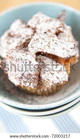 Raisin and Butter Bread Pudding Covered in Powdered Sugar