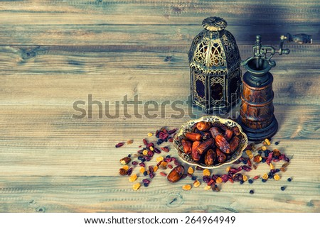 raisins and dates on wooden...