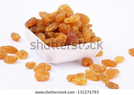 Raisins in a white bowl
