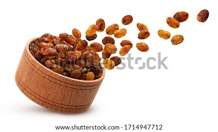 Raisins in wooden bowl isolated on white background with clipping path Stock photo ©