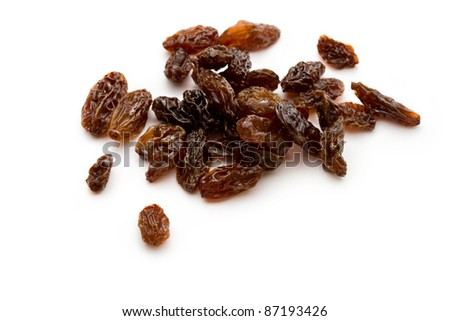 Raisins on the white background