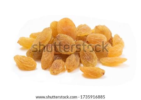 Raisins on white background, Isolated Raisin, Heap of yellow Raisins, Indian Kishmish.  Stock photo ©