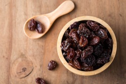 raisins on wooden table background