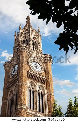 Rajabai Clock Tower at blue cloudy sky background in Mumbai, India