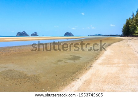 Rajamangala beach with limestone cliffs in the background,Trang province, Thailand