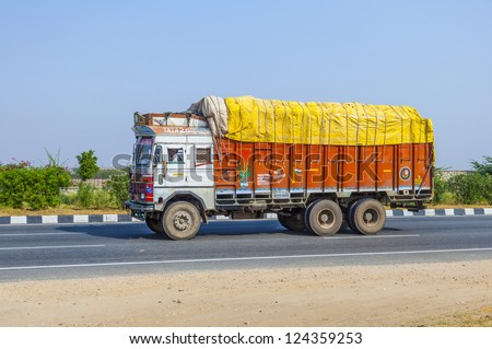 RAJASTHAN, INDIA - OCT 24: cargo transport with truck on highway on Oct 24, 2012 in Rajasthan, India. Roads is the dominant mode of transportation. They carry almost 65 percent of its freight.